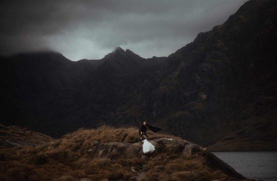 Couple climbing up hill at Loch Coruisk for elopement - Scotland Elopement Guide.